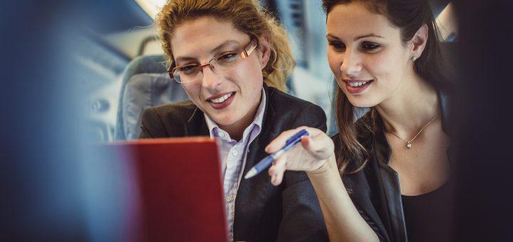 Businesswomen Taking Corporation Transportation